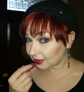 Lizzy wearing OCC Lip Tar in Strumpet.